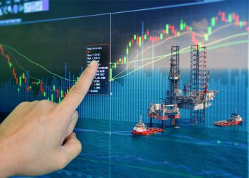 Stock market concept with oil rig in the gulf