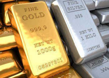 Closeup silver ingots and golden bullions in bank vault. Finance 3d illustration