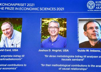 """The winners of the 2021 Sveriges Riksbank Prize in Economic Sciences in Memory of Alfred Nobel (L-R) David Card from the University of California, Berkeley, USA, Joshua D. Angrist from the Massachusetts Institute of Technology, Cambridge, USA and Guido W. Imbens from the Stanford University, USA, are seen on a screen during a press conference at the Royal Swedish Academy of Sciences in Stockholm, Sweden, on October 11, 2021. - Canadian David Card, Israeli-American Joshua Angrist and Dutch-American Guido Imbens won the Nobel Economics Prize for insights into the labour market and """"natural experiments"""", the jury said. - Sweden OUT (Photo by Claudio BRESCIANI / TT NEWS AGENCY / AFP) / Sweden OUT (Photo by CLAUDIO BRESCIANI/TT NEWS AGENCY/AFP via Getty Images)"""