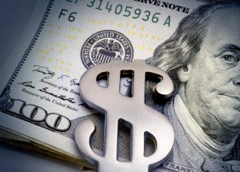 Money clip with bills closeup.