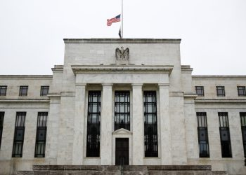 """This May 22, 2020 photo shows the Federal Reserve building in Washington. The Federal Reserve said Monday, June 15, 2020 that it will begin purchasing corporate bonds as part of a previously-announced program to ensure companies can borrow through the bond market during the pandemic The program will purchase already-issued bonds on the open market and will seek to build a """"broad and diversified"""" portfolio that will mimic a bond-market index. (AP Photo/Patrick Semansky)"""